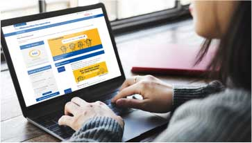 A user is looking at a laptop displaying our member portal